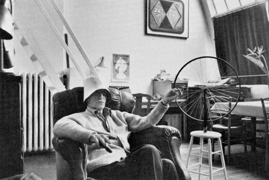 Duchamp wearing a lampshade with Bicycle Wheel, 1951