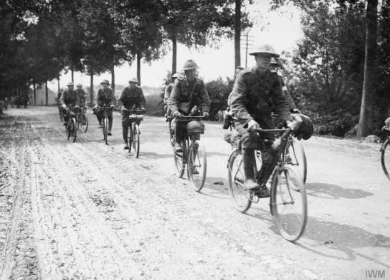 Cyclists on the Ypres-Poperinghe Road, July 1916. © IWM (Q 838)