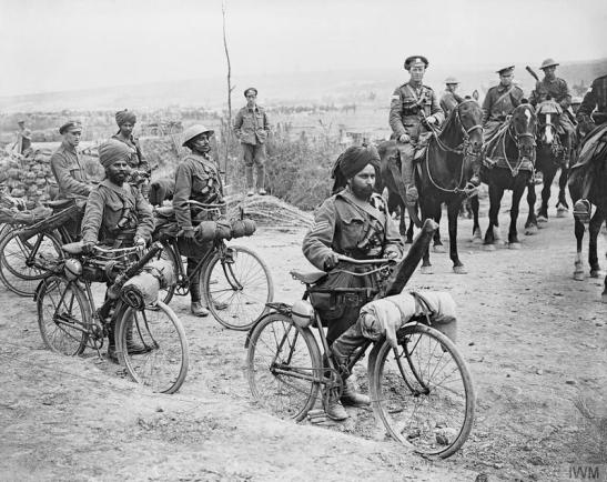Indian cyclists at a crossroads on the Fricourt-Mametz road. Somme 1916. © IWM (Q 3983)