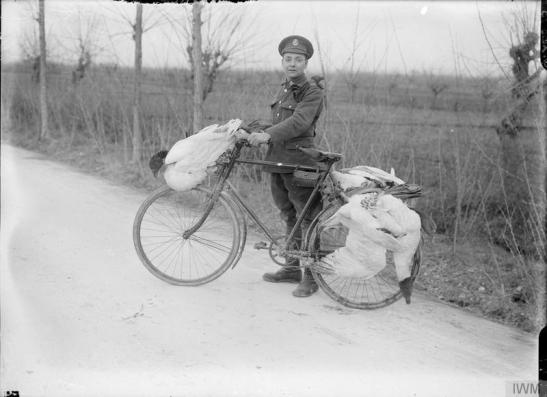 A cyclist of the 8th Battalion, York and Lancaster Regiment (70th Brigade, 23rd Division) with geese attached to his bicycle. Italian Front. © IWM (Q 26575)