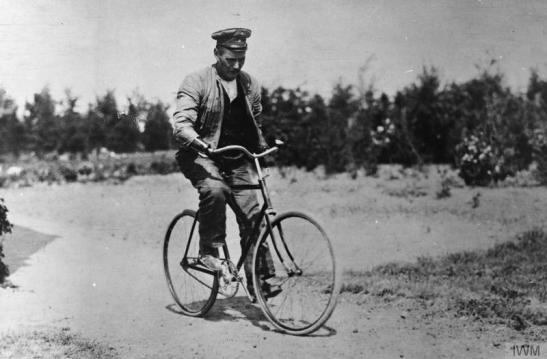 German disabled soldier with both artificial arms riding a bicycle on the way to work at a workshop in Hindenburg's house at Konigsberg. Every disabled German soldier could claim by law to be provided with mechanical limbs. © IWM (Q 88179)