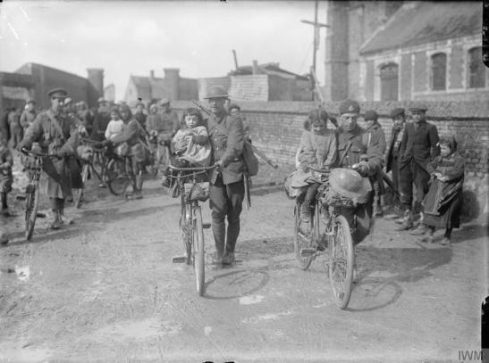 © IWM (Q 1886)  Cyclists passing through the village of Vraignes (Vraignes-en-Vermandois), March 1917.