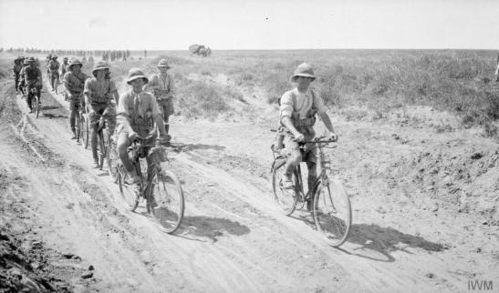 Cyclists on the road. © IWM (Q 24711)