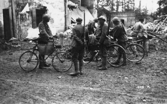 "Cyclists of the Arditi (""Daring Scouts"") in Fornaci Square, Piave Front, east of Treviso. IWM Q 65223"