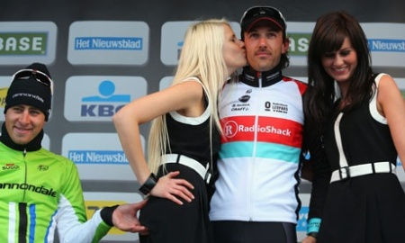 Peter Sagan pinches Maja Leye's behind on the winner's podium, Tour of Flanders 2013.  Bryn Lennon/Getty Images