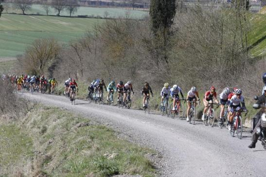 Riders on the white roads during the 2015 Women's edition of the Strade Bianche. Bettini Photos