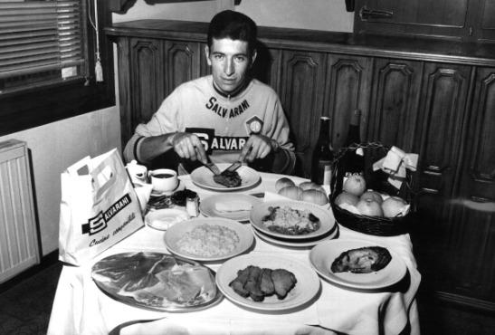 The Italian cyclist Felice Gimondi eating his daily food ration during the Giro d'Italia. Sanremo, 24th May 1968 (Photo by Giorgio Lotti/Mondadori Portfolio via Getty Images)