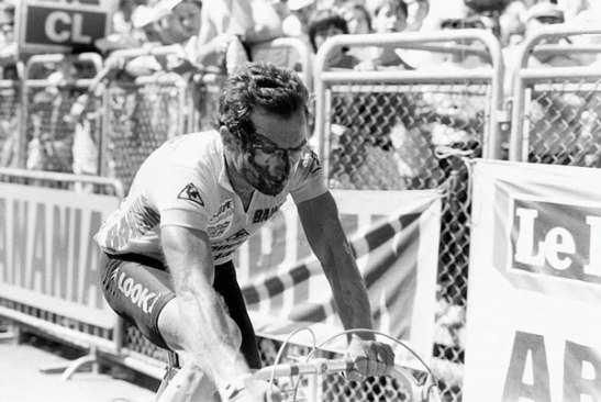 Bernard Hinault rides to the finish line after his crash on stage 13 of the 1985 Tour de France