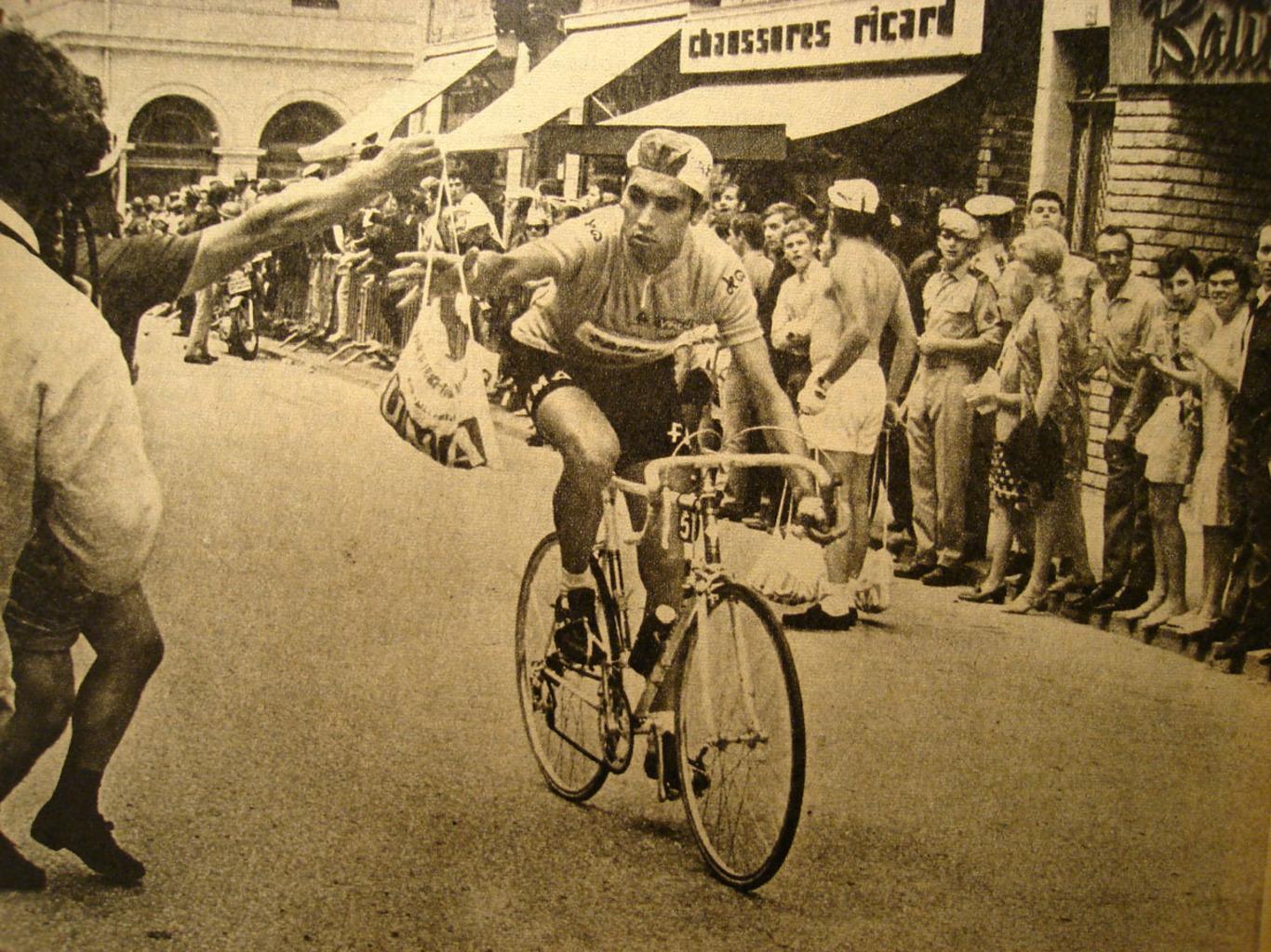 Eddy Merckx grabbing a musette
