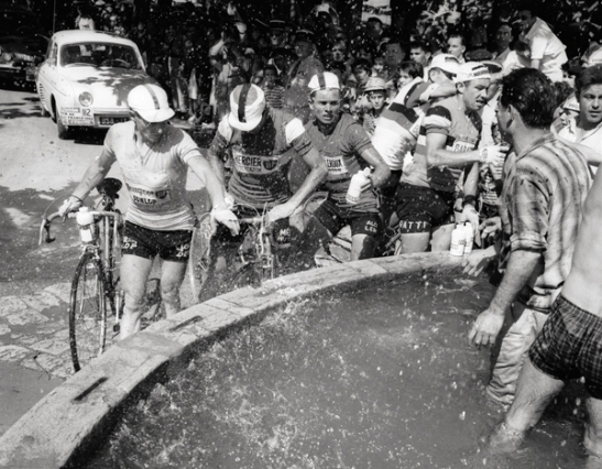 Riders stop at a fountain during stage 12, 1961