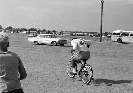Running back Travis Williams rides a bike from the practice field to the locker room at Lambeau Field during training camp in late July 1969. © Press-Gazette Media archives.
