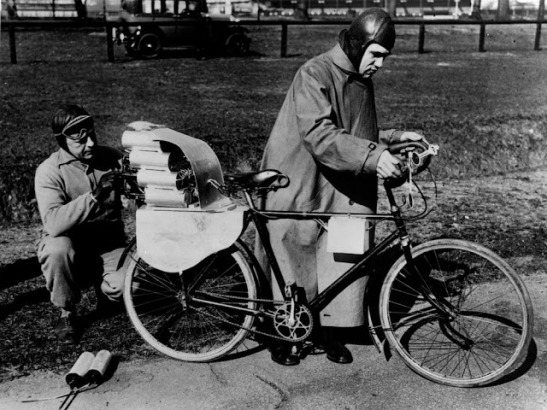 24th March 1931: German engineer Richter with his assistant adjusting the rockets on his cycle before a test drive. (Photo by Topical Press Agency/Getty Images)